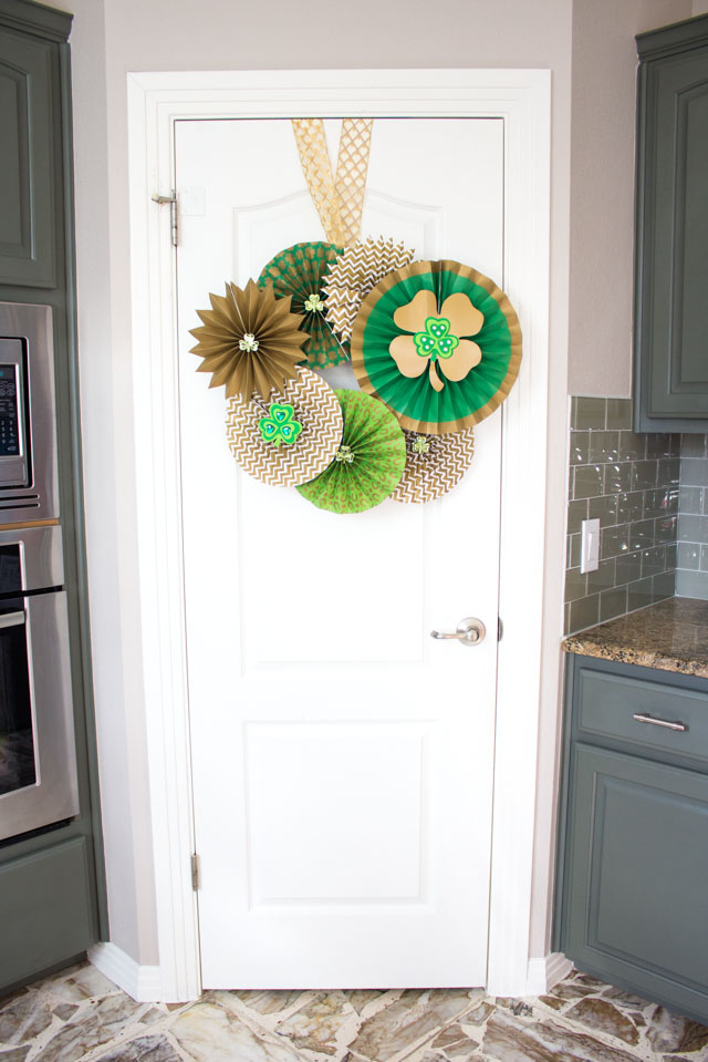 Make a St. Patrick's Day Wreath out of paper party fans and shamrocks!