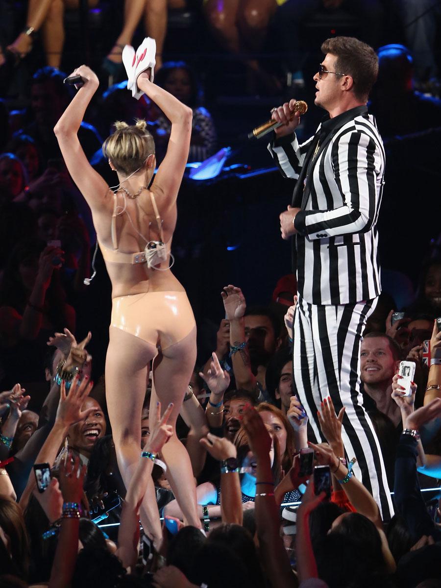 Miley cyrus twerking two black dicks 1