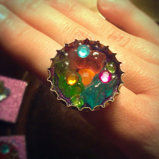 Mini gummy bears and gems in a bottle cap ring