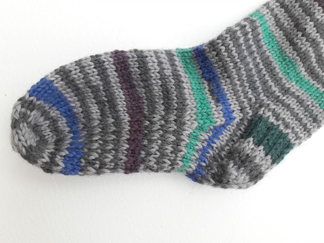 Reinforced heel and sole on hand knitted sock