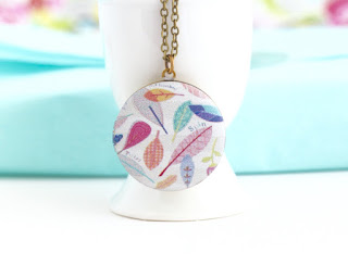 http://www.jacarandadesigns.com/collections/lockets/products/boho-necklace-feather-jewelry-pastel-locket-locket-necklace-photo-locket-pretty-colorful-locket-pendant-brass-locket