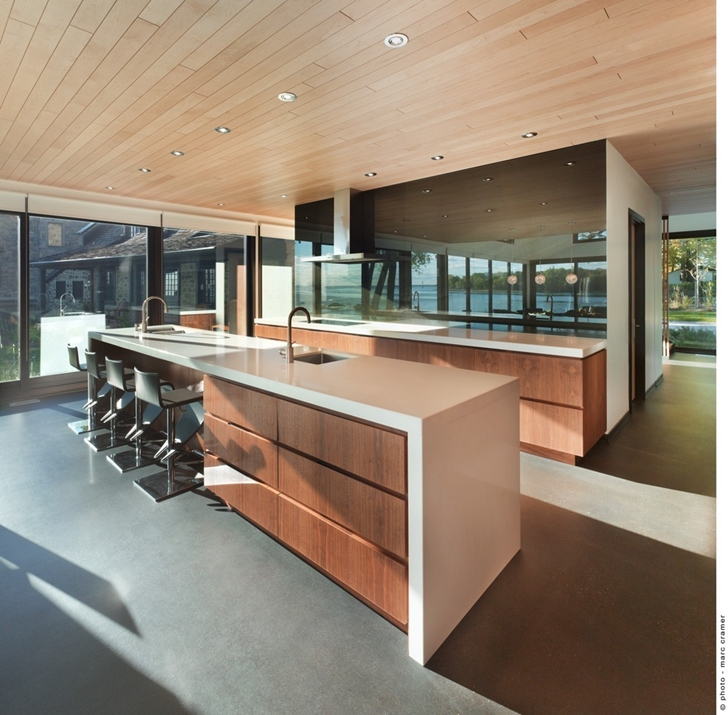 Modern kitchen in Renovated Bord-du-Lac House by Henri Cleinge