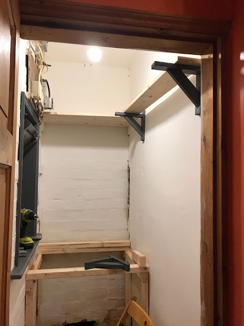shelves in laundry cupboard