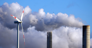 Wind tower by smokestack (Credit: bnef.com) Click to Enlarge.