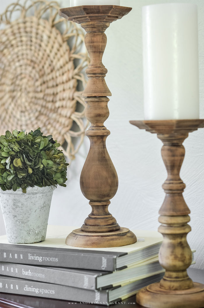 Add some farmhouse style to your home with these simple DIY rustic wood candlesticks.  #fixerupper #DIY #farmhousedecor #thriftstore  |#andersonandgrant