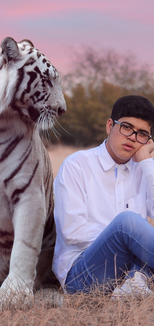 A boy with pet tiger.