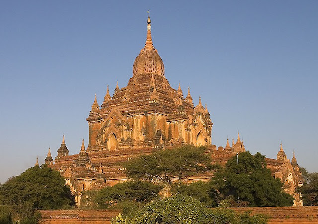 The Htilominlo Temple, Bagan, Myanmar, is a Buddhist pagoda built in 1211 AD. It is modeled on a stupa, with its ascending staircases, hemispherical mound and high spire