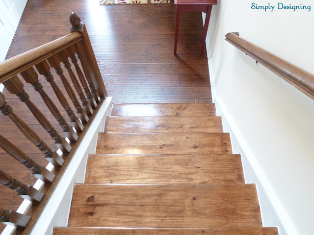 Photo of wood stairs that need to be restained because they don't match installed laminate floors