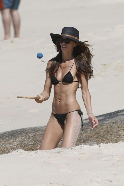 Izabel Goulart in Black Bikini on the beach in Rio