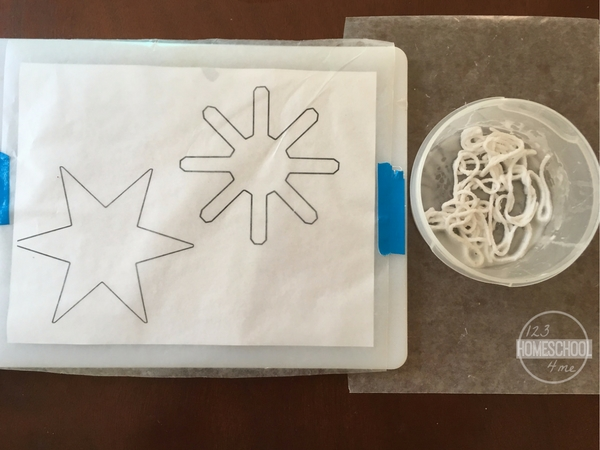 snowflake crafts using wax paper, yarn, school glue, and jewels