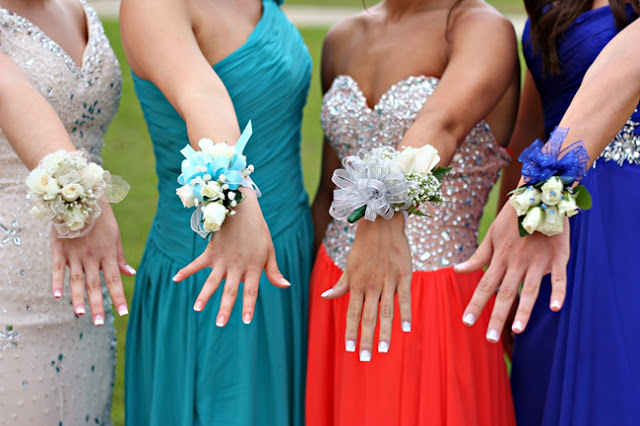 girls show theirs corsages