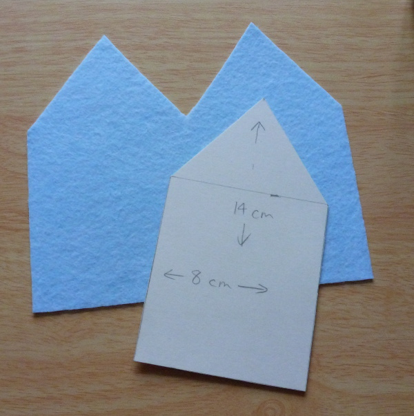Blue felt house shaped outline cut from cardboard template