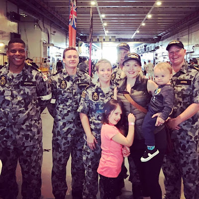 "HTML: <img src=""/images/katebranch.jpeg"" alt=""Kate Branch and family on the HMAS navy boat"" />"
