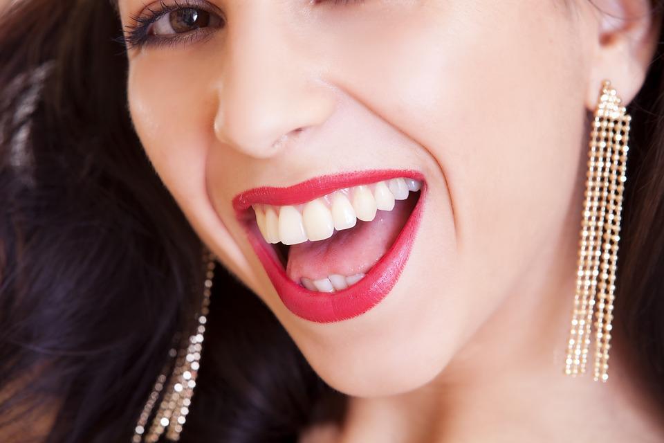 smiling-woman-showing-her-teeth.jpeg