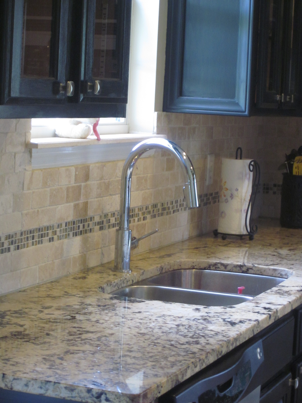 finished kitchen delta trinsic kitchen faucet And the cabinet knobs I consider them a work of art They are good quality heavy knobs I bought them at Gliderite Hardware online