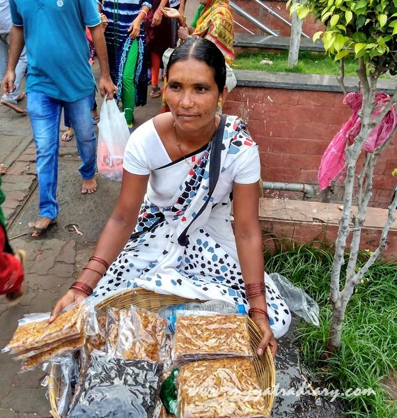 Sunita Jhadav selling chikkis at Sai Baba Samadhi Temple complex, Shirdi
