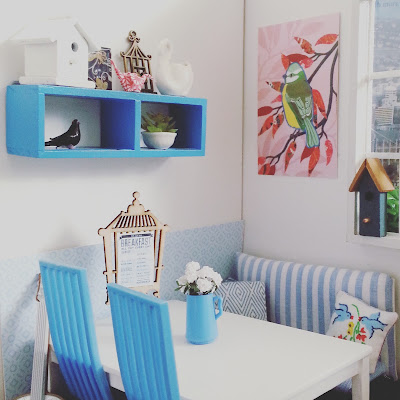 One-twelfth scale modern miniature cafe scene, in blue and white with a bird theme.