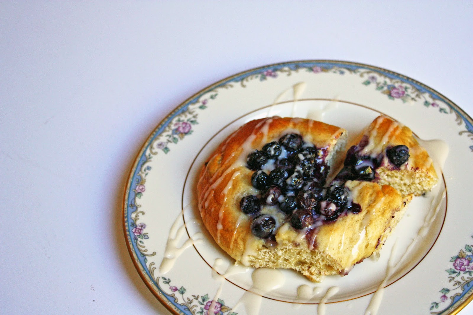 Mustikkapiiraat (Finnish blueberry-filled breakfast buns) with vanilla glaze