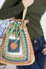 http://www.redheart.com/free-patterns/granny-drawstring-tote-bag