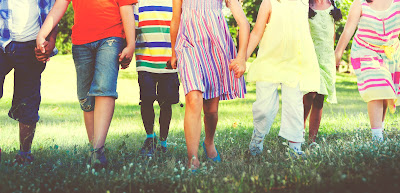 group of kids walking holding hands