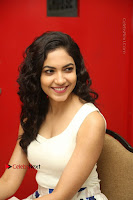 Actress Ritu Varma Stills in White Floral Short Dress at Kesava Movie Success Meet .COM 0202.JPG
