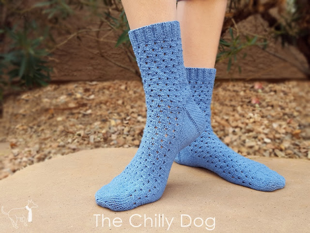 Free Knit Sock Pattern: Cotton/bamboo yarn and an airy eyelet stitch go together like a wink and a smile.