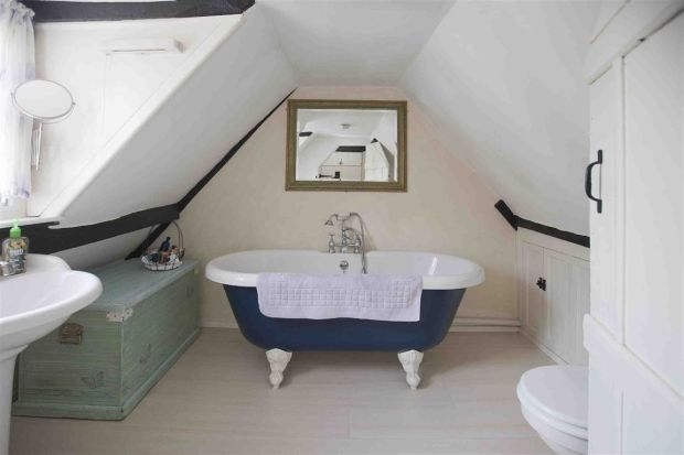 Eaves cottage bathroom with clawfoot tub