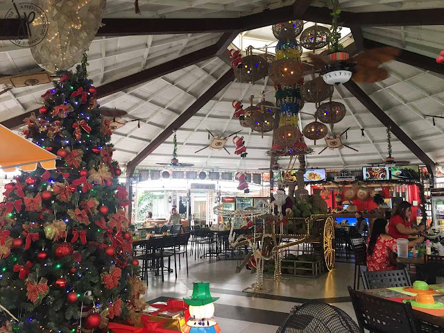 ventilated restaurant with christmas tree and holiday decors
