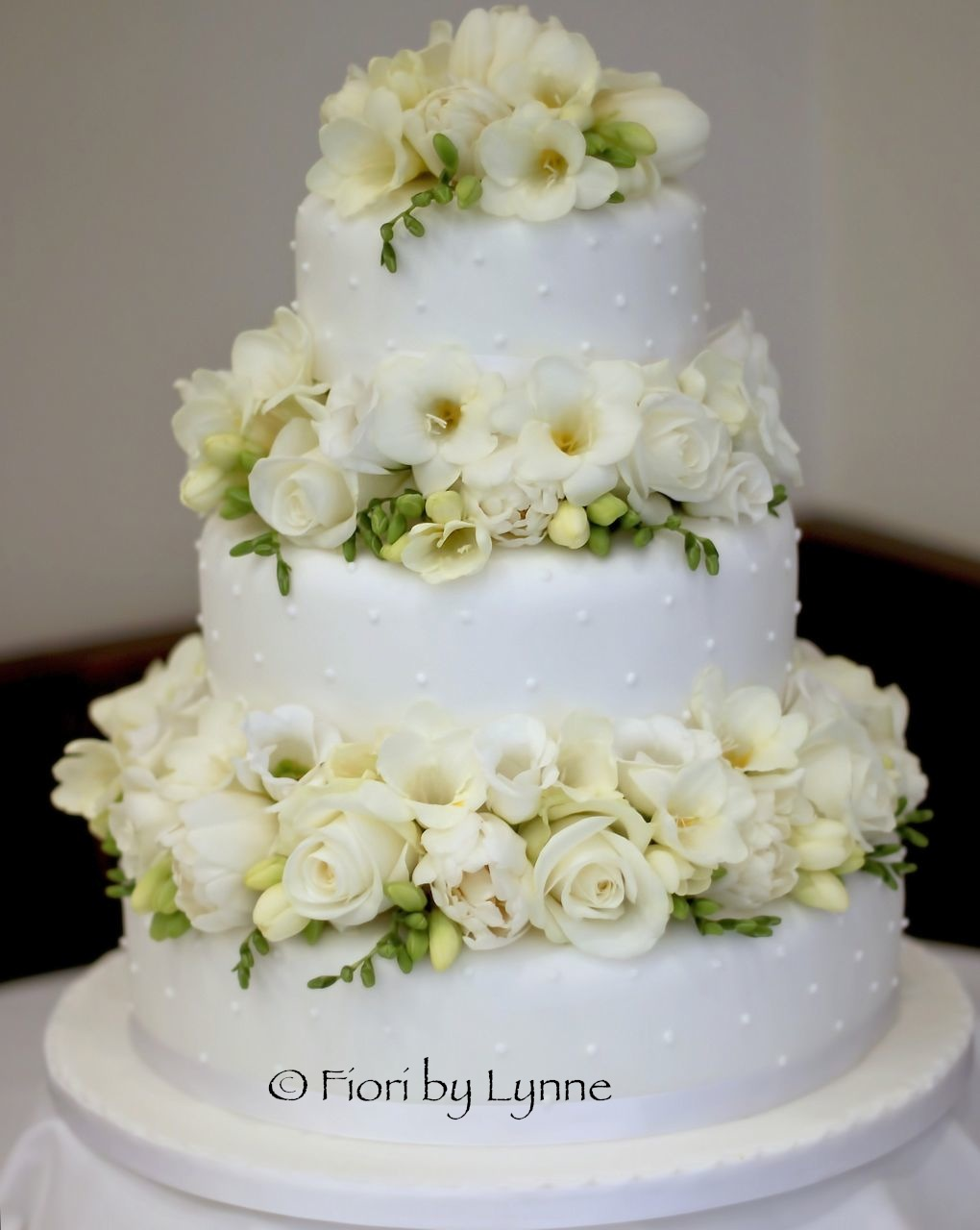 Wedding Cake With Roses Between Tiers