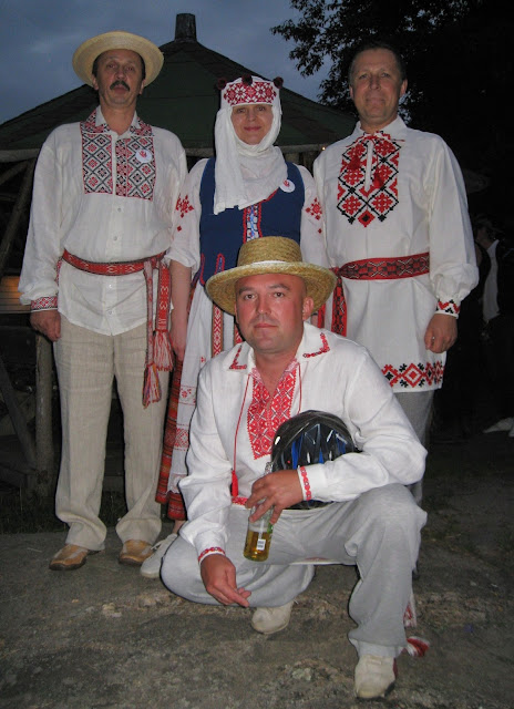Belarus men and a woman wearing traditional costume