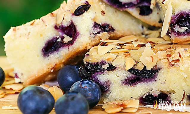close up photo: slice of almond blueberry butter cake