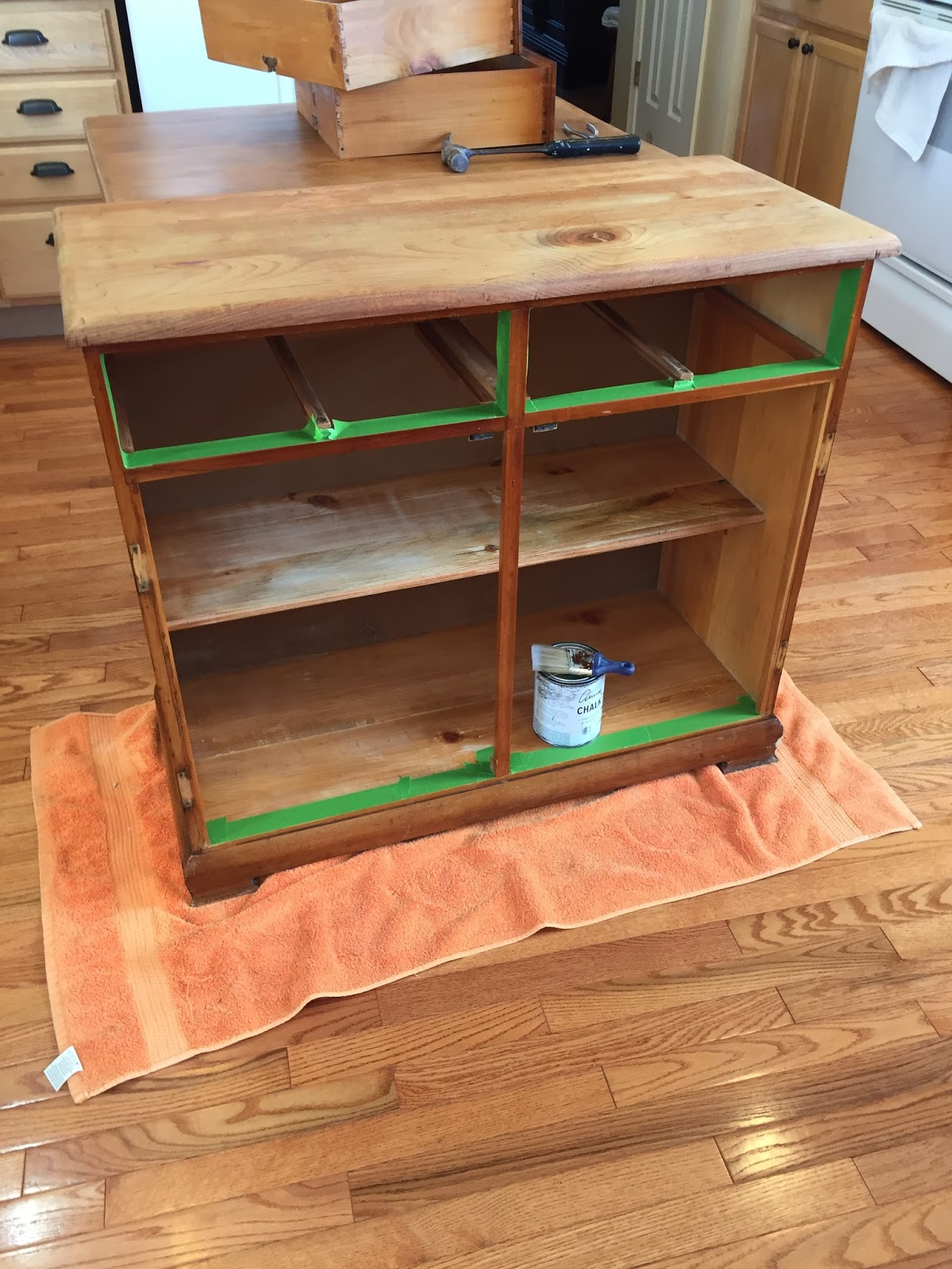 Preparing to paint bottom cabinet