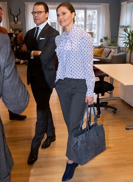 Princess Victoria wore a navy blue coat by Greta Stockholm, and polka-dot silk blouse by Greta. Af Klingberg suede boots. diamond earrings