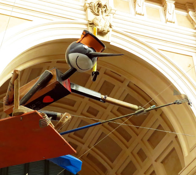 Pinocchio with mask, flippers, and spear, Mercato Centrale (Central Market), Livorno