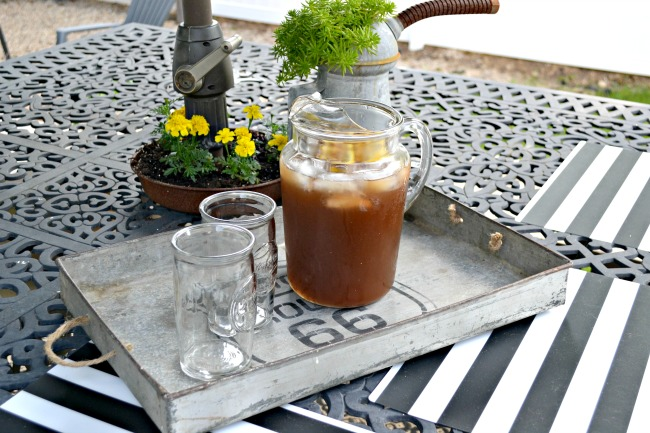 Iced tea pitcher in industrial tray