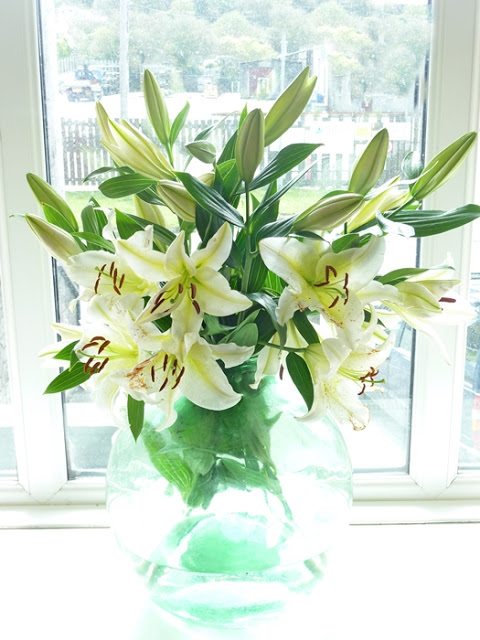 a bowl of lilies