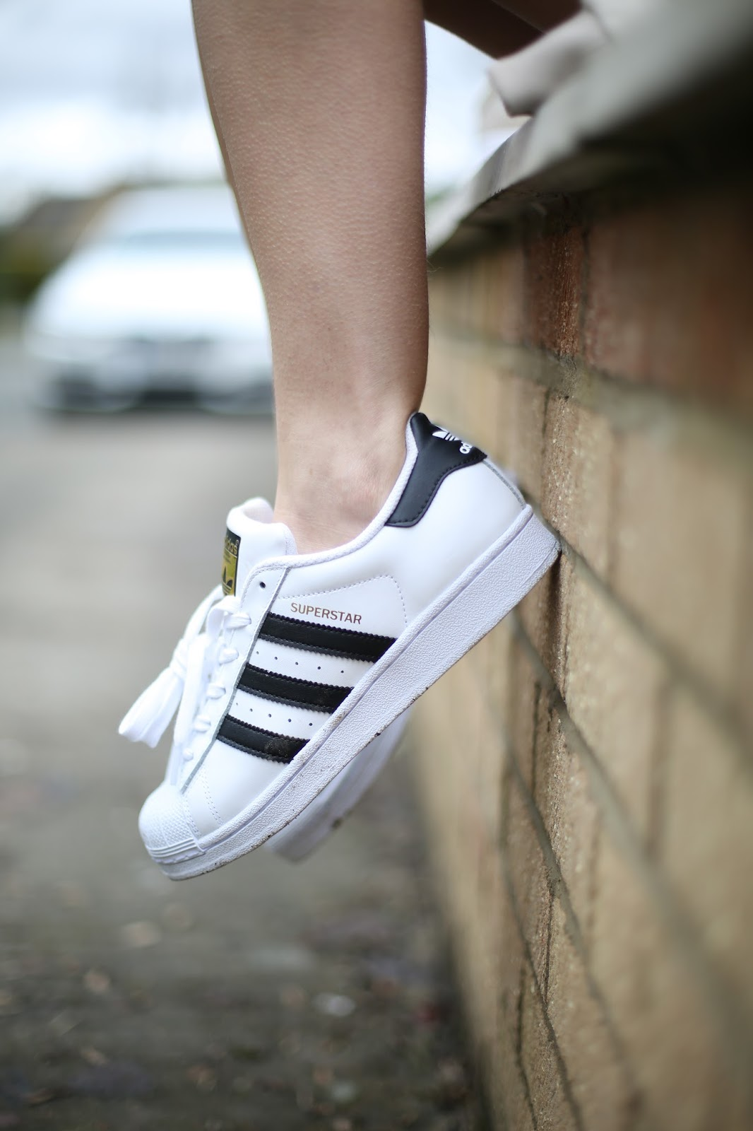 Adidas black stripe trainers