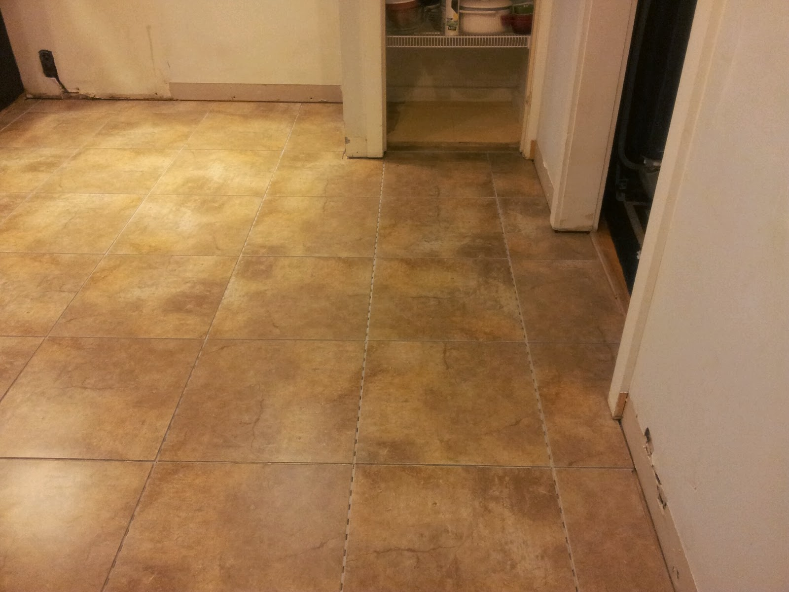 The Kitchen Floor From Another Angle Showing Pantry Area Again We Saw No Need To Tile Inside Since Will Be Installing More Shelving At