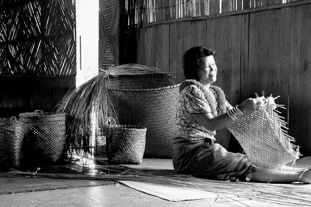 Photo of Iban lady weaving baskets