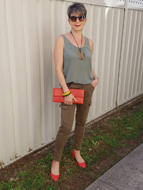 Green cargo pants-green sleeveless top-red shoes|red hadnbag