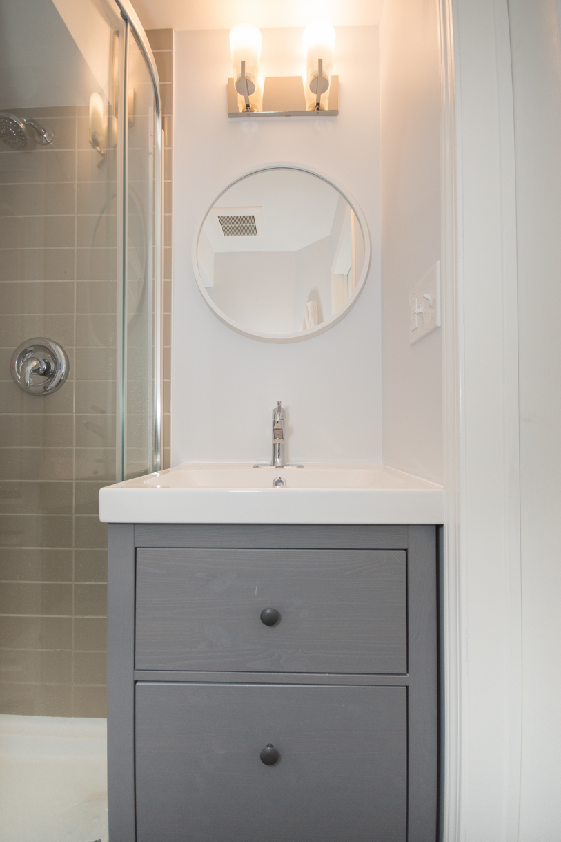round mirror in washroom vanity