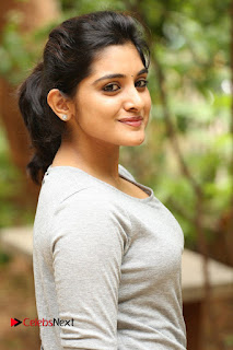 Actress Niveda Thomas Pictures in Black Jeans at Gentleman Movie Interview  0049