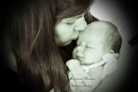 image Photograph -Captured Moments mother cradling new born tenderly kissing baby's forehead