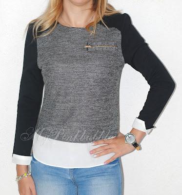 camiseta gris y negra