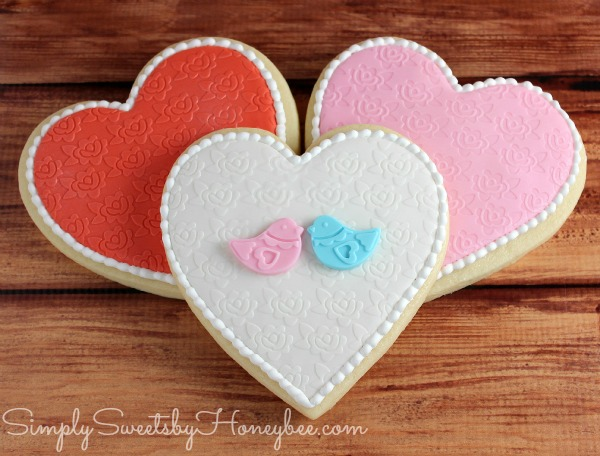 i started by rolling out my fondant embossing it i used an embossing folder from cuttlebug that you can find at your local craft stores - Decorated Valentine Cookies