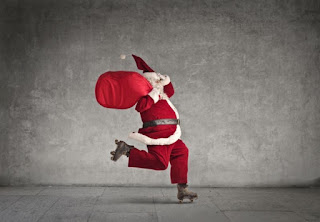 Santa Claus zooming by on roller skates with a large red bag over his shoulder