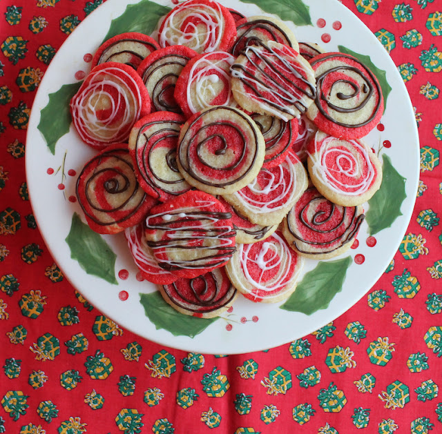 Food Lust People Love: Peppermint dough and mint chocolate swirls or peppermint glaze - or both! - make these pretty peppermint pinwheel cookies. They are perfect for your Christmas table or cookie exchange.