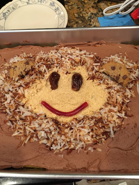 Monkey Face Birthday Cake using toasted coconut, chips ahoy cookies, crushed graham crackers, licorice, and dates for the eyes