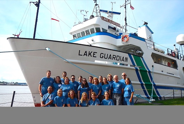 Participants in front of the Lake Guardian ship
