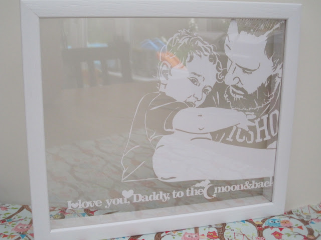 Paper cut version of the photo with the words 'I love you Daddy, to the moon and back'